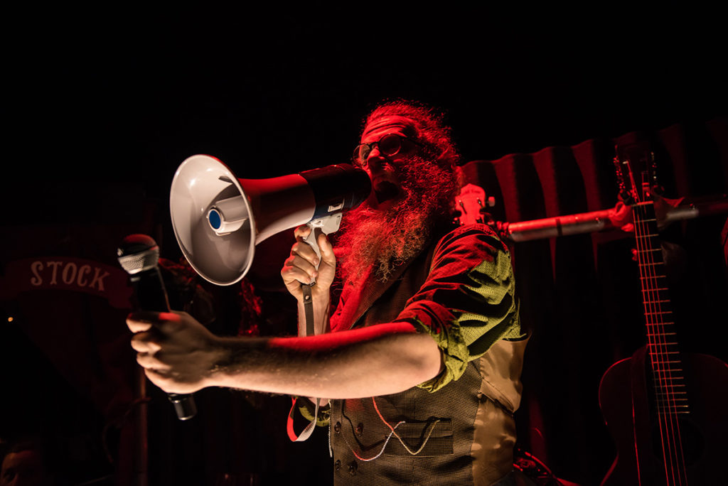 Image: Ben Caplan as The Wanderer in Old Stock: A Refugee Love Story. Photo by Stoo Metz Photography